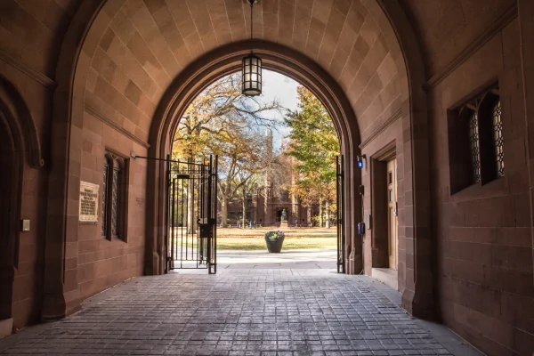 Archway leading to a university campus