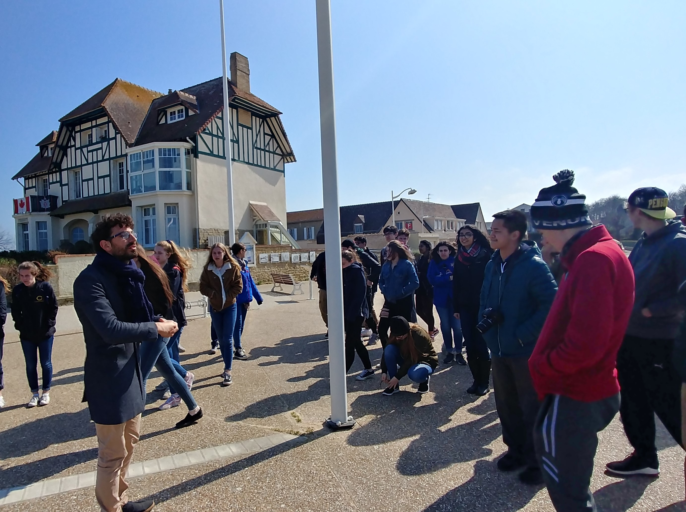 Students in front of Canada House in Arromanches