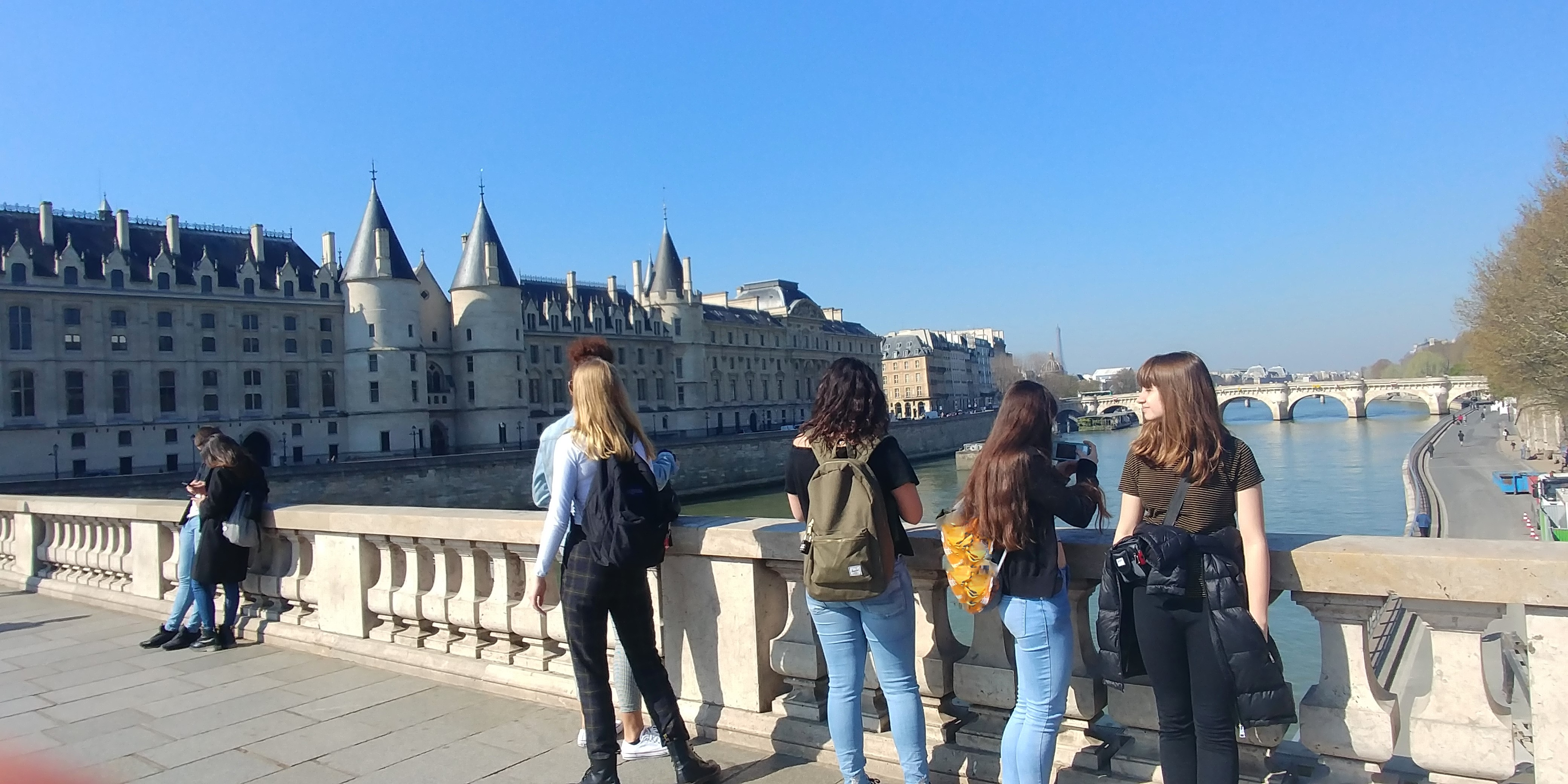 Students posing in front of the Conciergerie in Paris