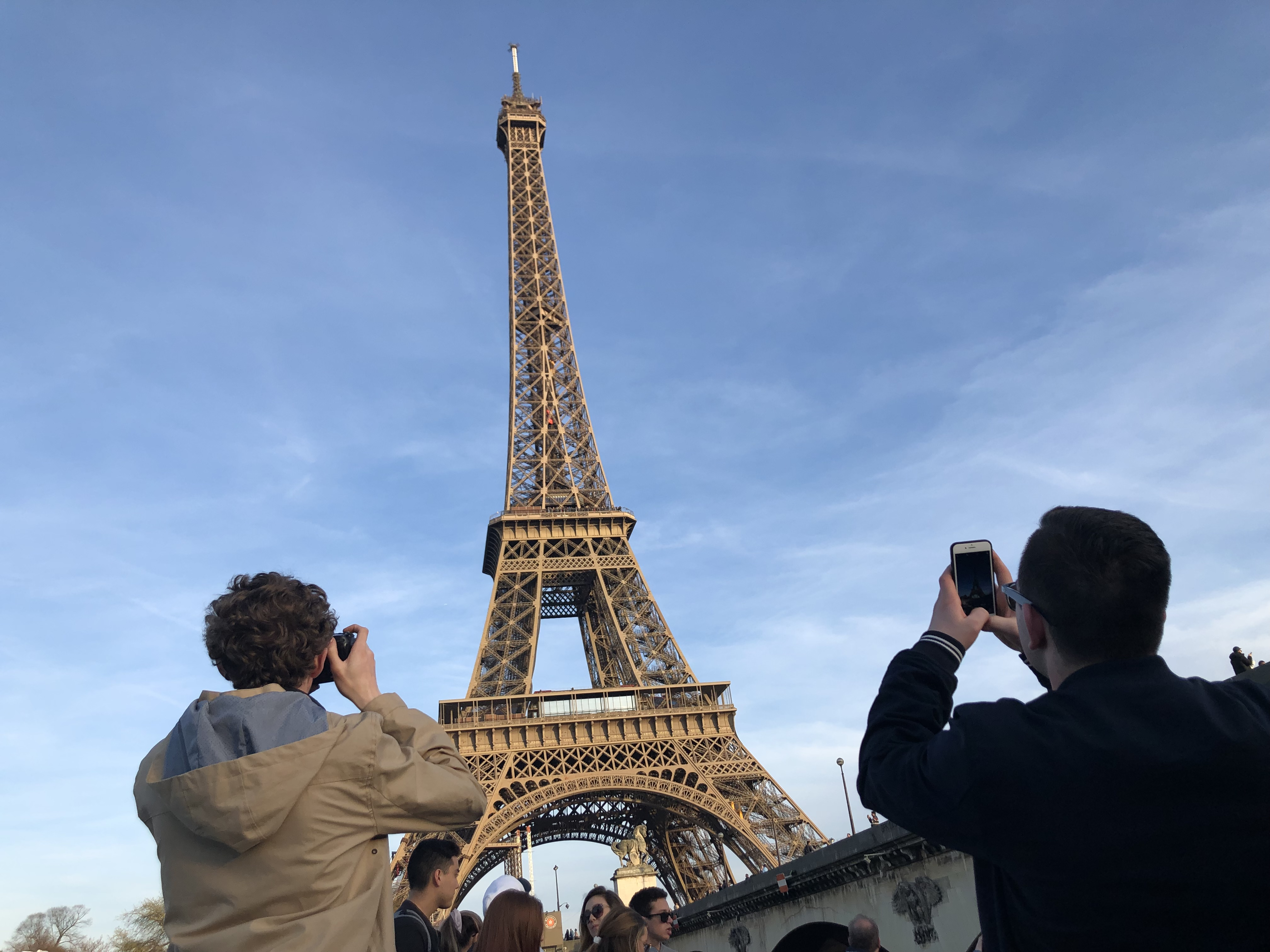 Students taking a picture of the Eiffel Tower