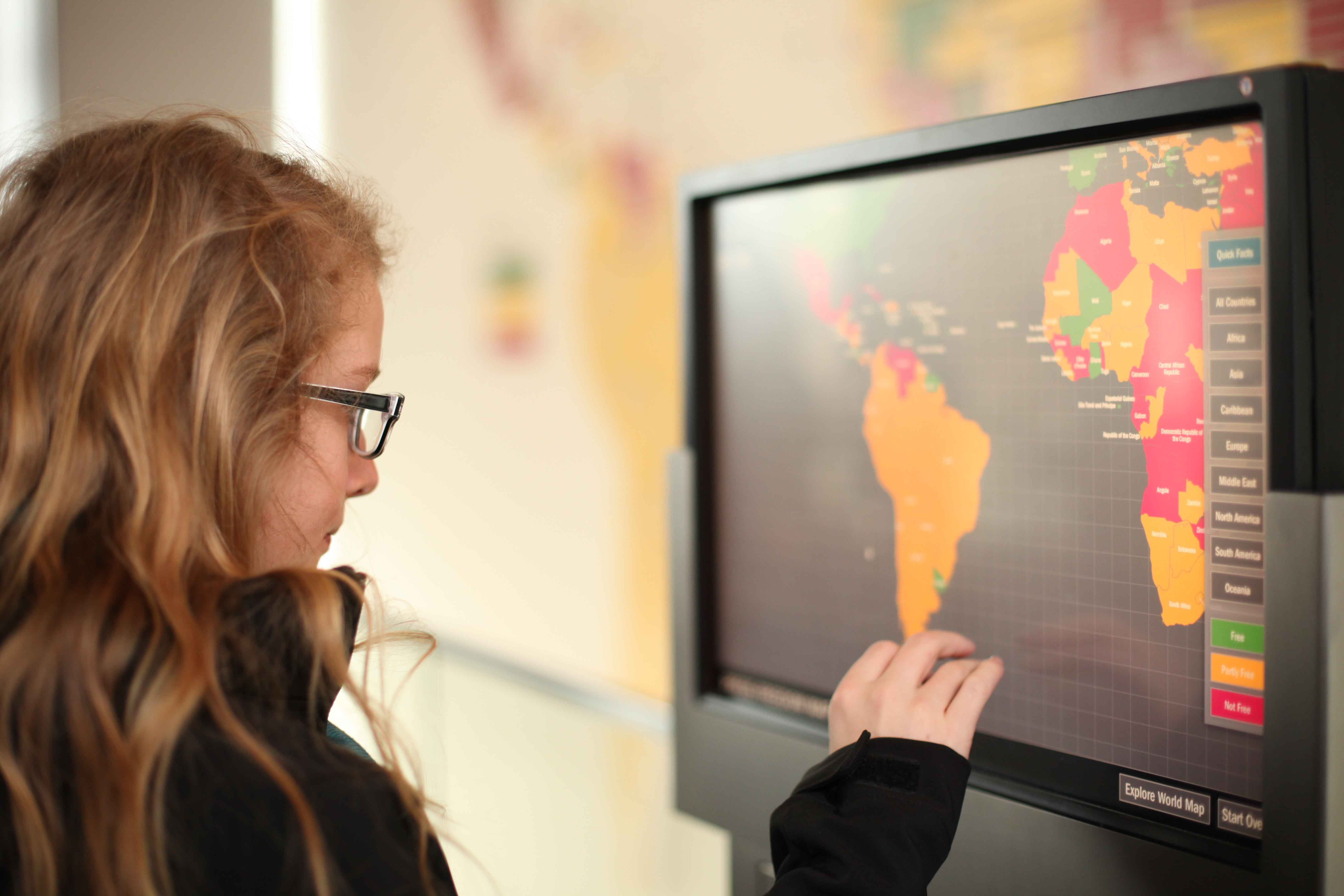 Girl looking at an interactive map at the Smithsonian, Washington D.C.