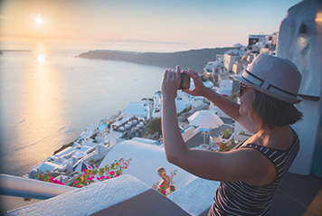 Student taking a picture in Santorini