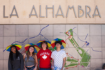 Students wearing funny hats at the entrance of the Alhambra