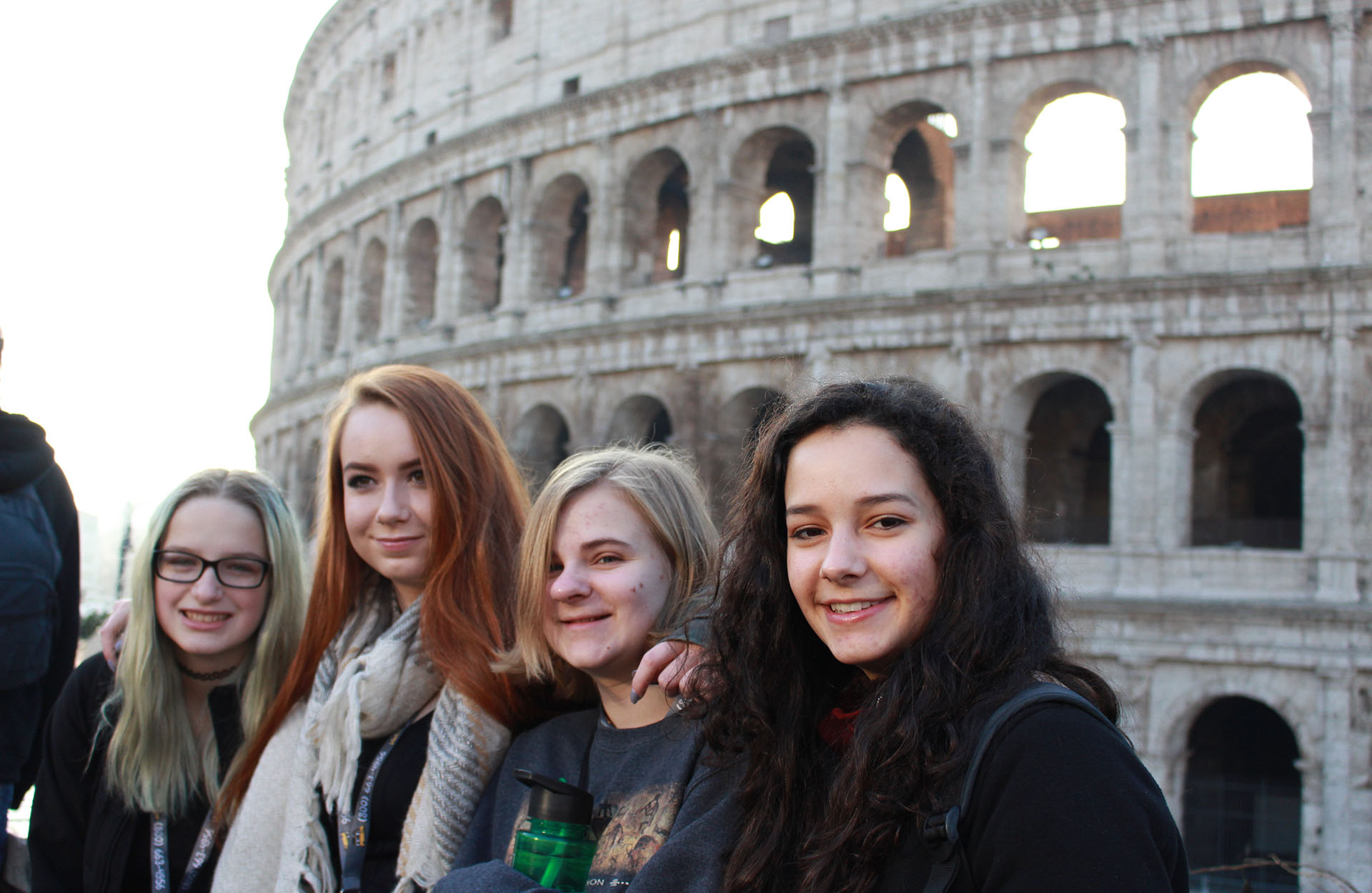 Young girls in front of the Colosseum in Rome