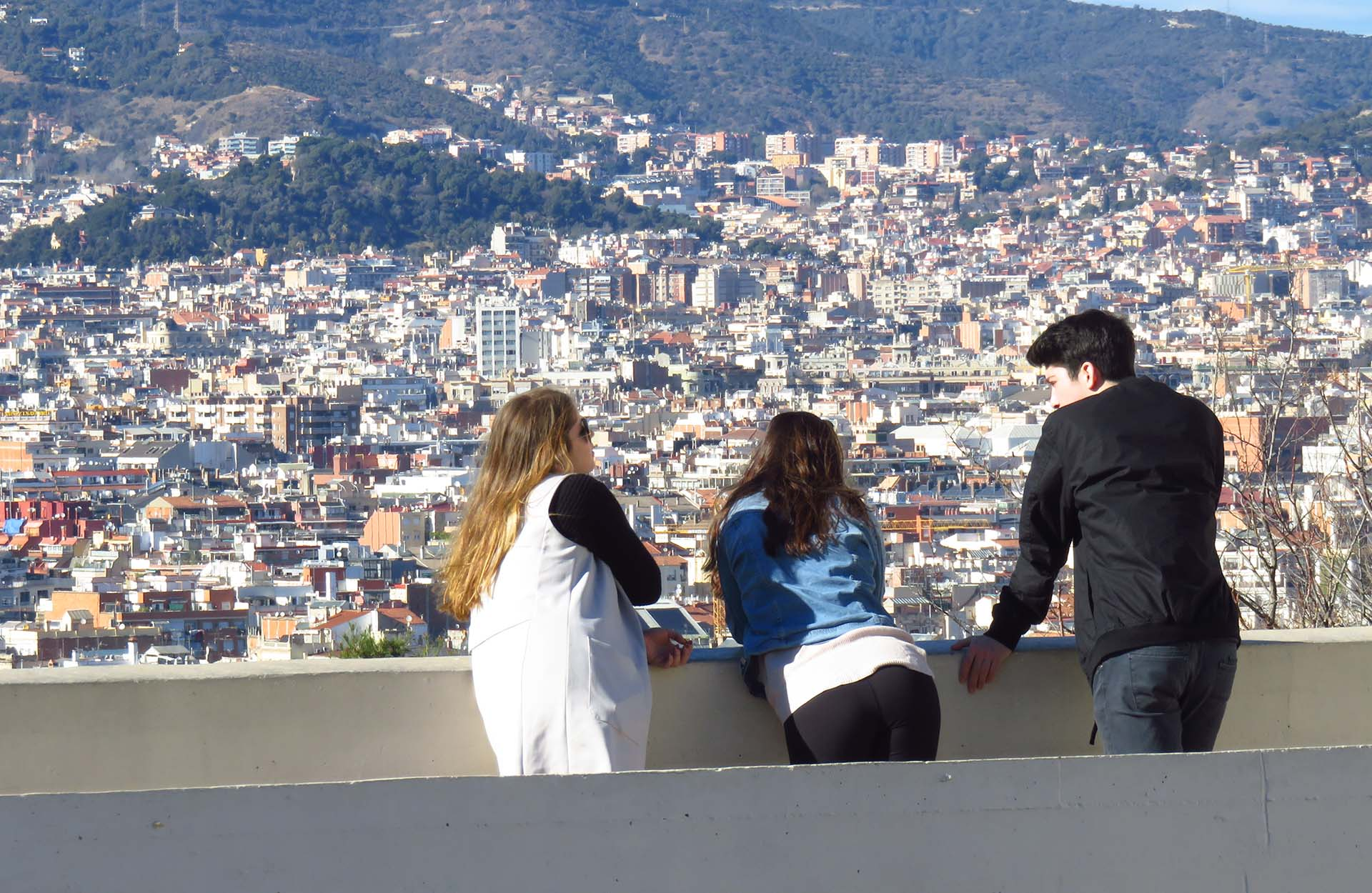 Three students watching a view in Spain