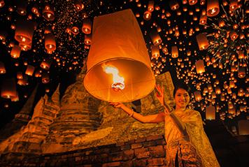 Lighting up a lantern in Thailand