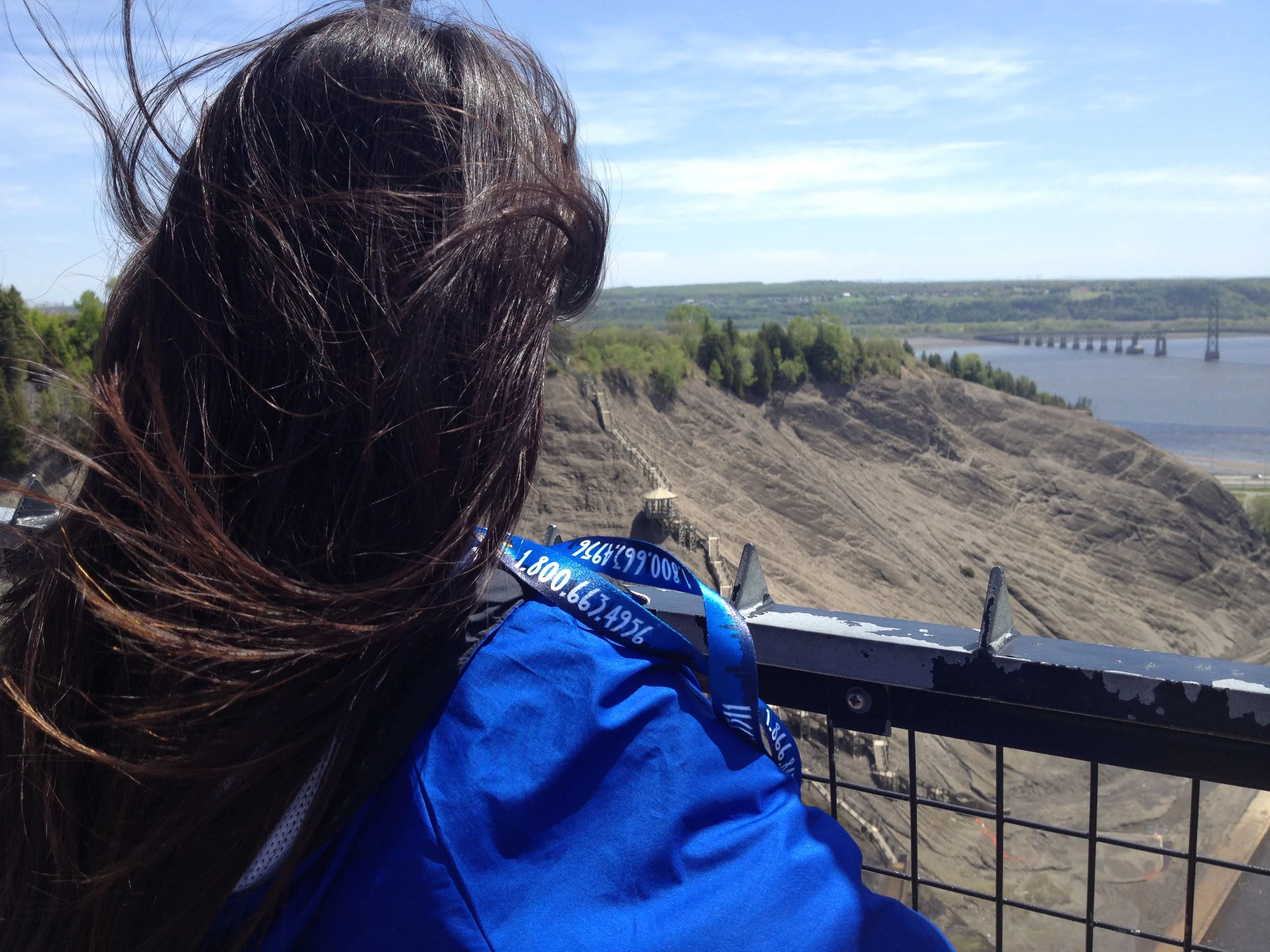 Student looking out past the Montmorency Waterfalls.