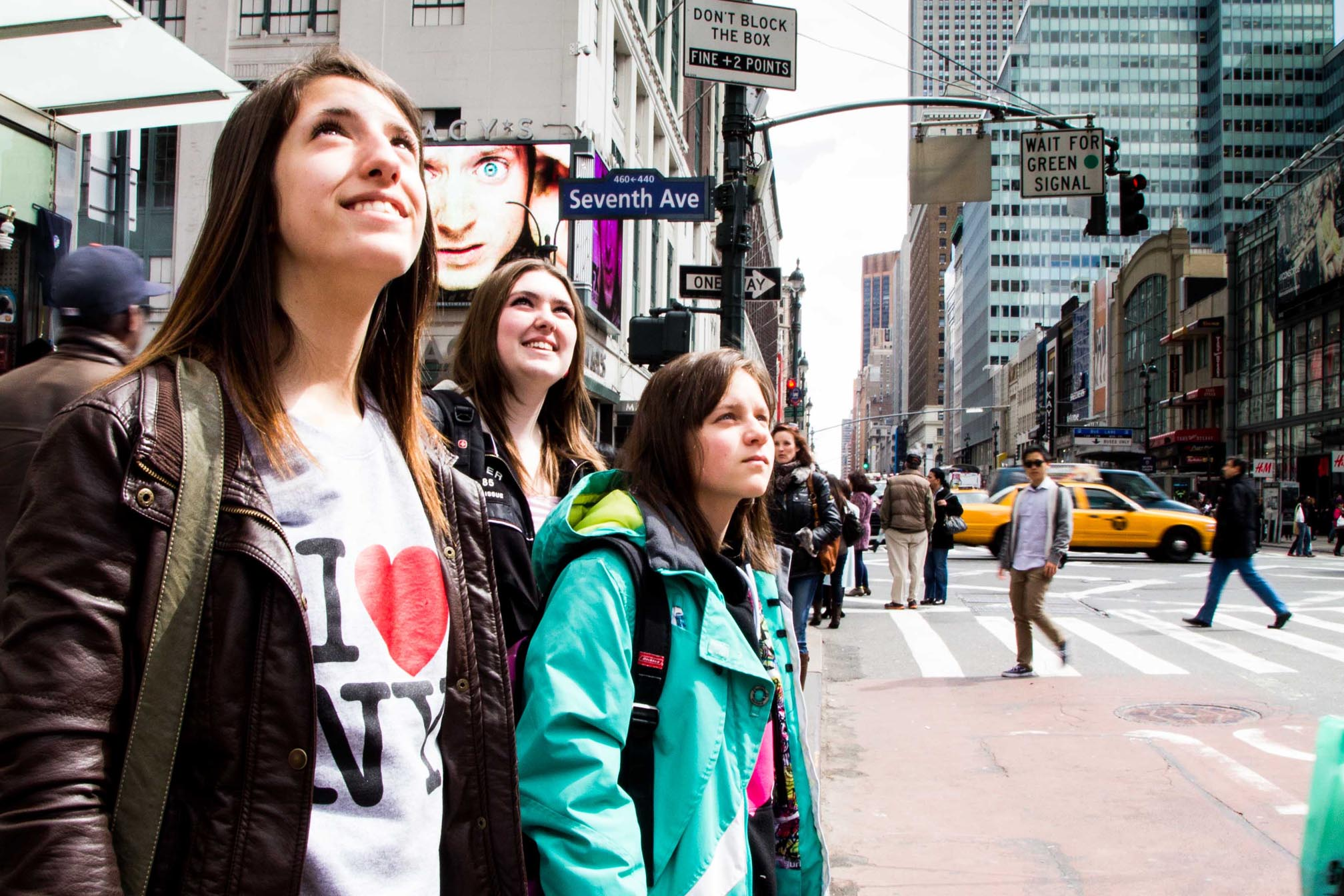Students looking at the skyscrapers in Time Square