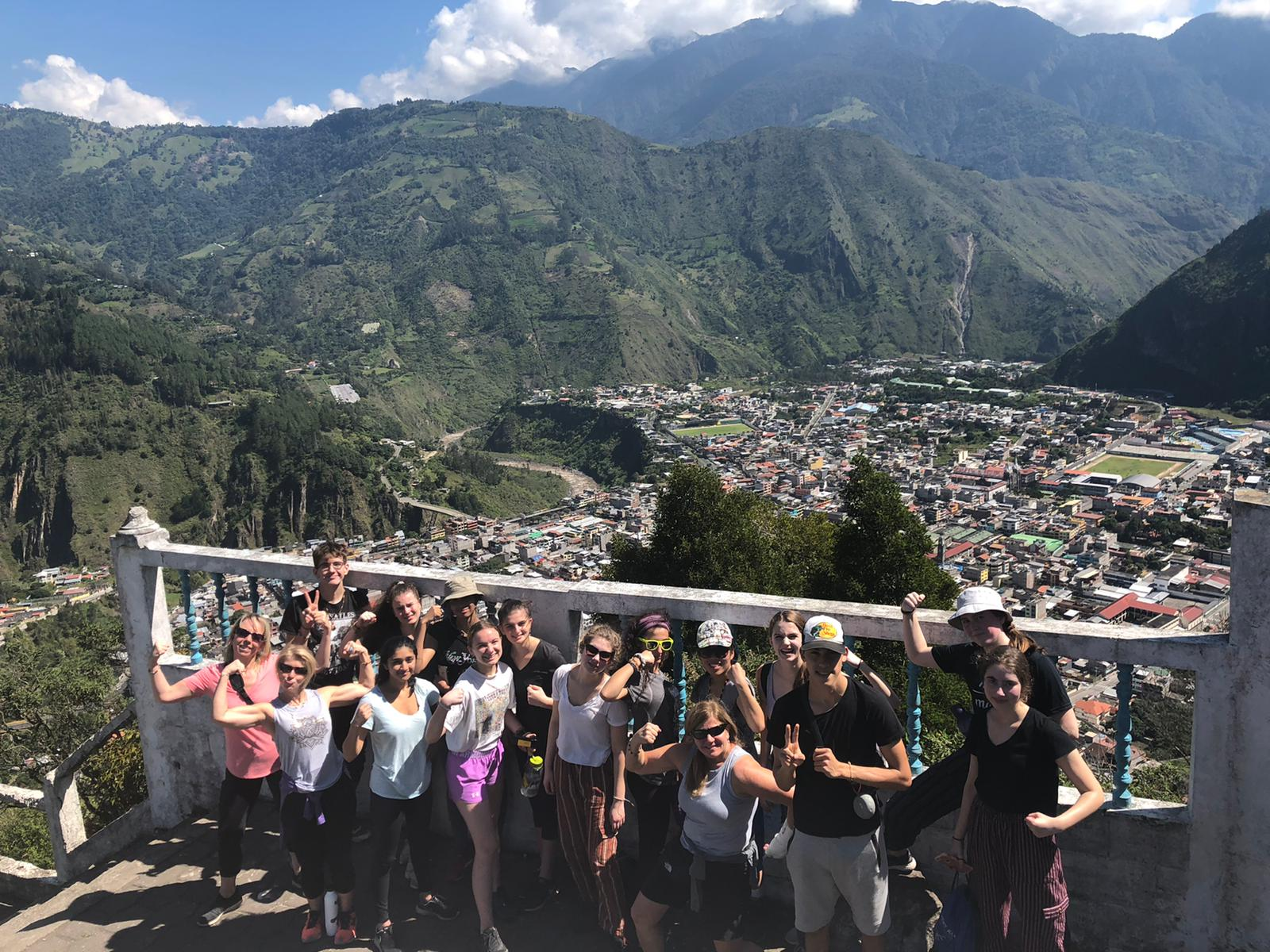 Students smiling at the camera from a viewpoint in Ecuador