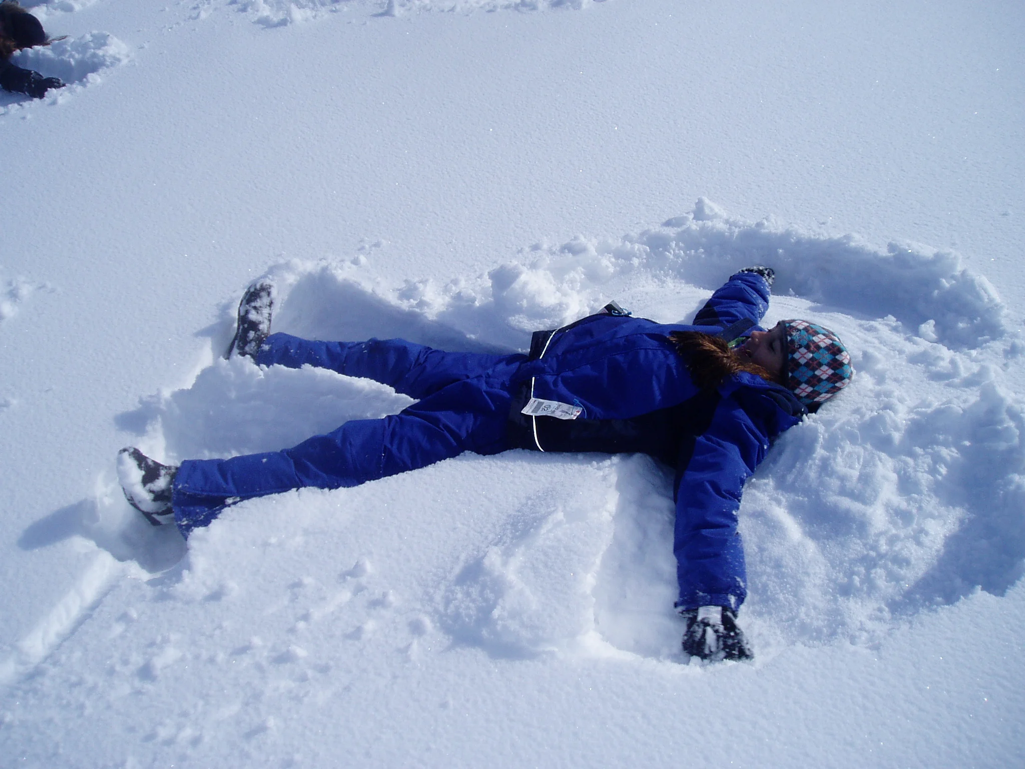 Student making a snow angel.