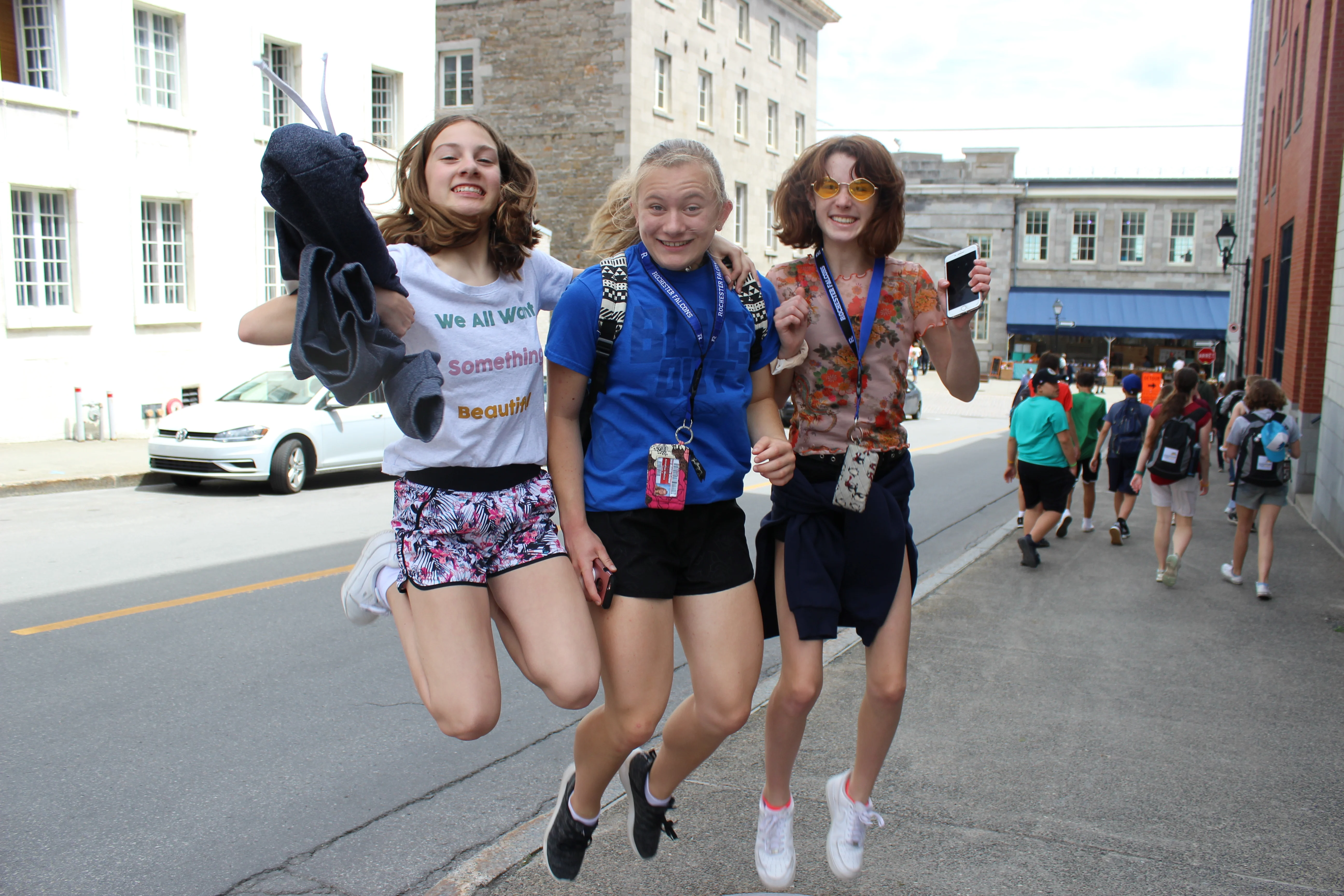 Students jumping with joy in Montreal.
